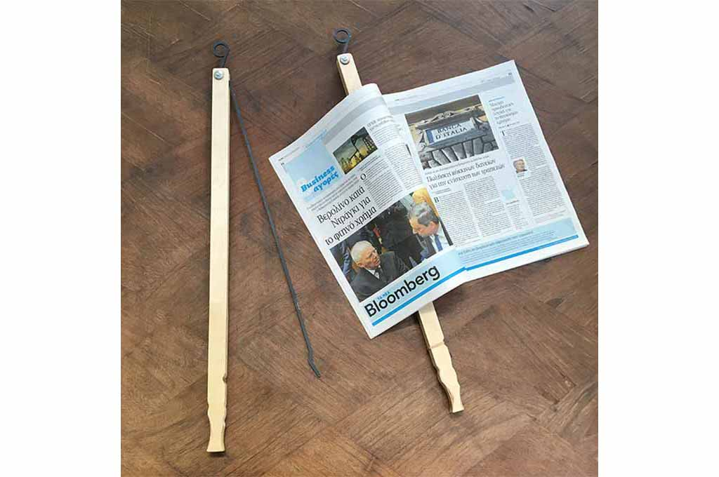 News Paper Holding Stick